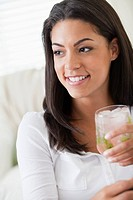 Young woman sitting with drink (thumbnail)