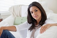 Woman sitting on sofa (thumbnail)
