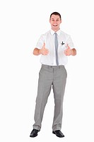 Portrait of an office worker with the thumbs up against a white background