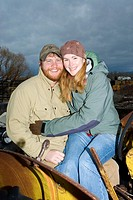 Young couple on tractor