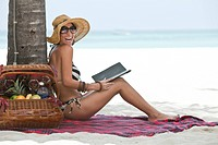 Laughing Woman With Electronic Book on Beach, Aruba