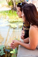 Attractive Hispanic Couple Overlook Pond