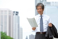 Senior businessman with newspaper