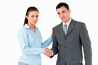 Business partners closing a deal against a white background