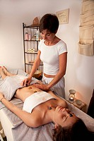 Woman getting gemstonetherapy massage                                                                                                                 ...