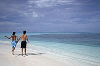 Couple at a beach at Coco Palm Dhuni Kolhu Resort in Maldives                                                                                         ...