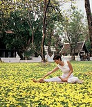 Woman doing stretching at Dhara Dhevi Mandarin Oriental Spa Chiang Mai , Thailand                                                                     ...