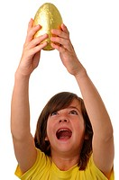 Girl 10_12 years old holding an Easter egg with an excited expression on her face