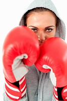 Young female boxer with hoodie on against a white background