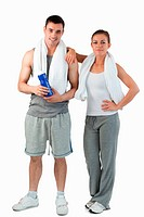 Portrait of a young couple going to practice sport against a white background
