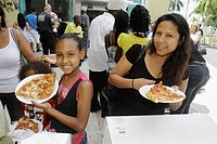 Florida, North Miami Beach, Police Station, Neighborhood Football League Awards Ceremony, lunch, Black, girl, daughter, woman, mother, pizza, slice, p...