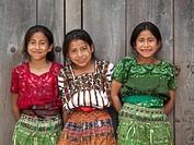 Three Guatemalan girls smiling for photo