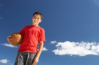 Teenage boy holding football