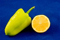 green pepper and lemon on blue bacground