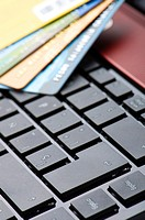 credit cards and a computer for online shopping