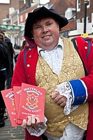 Man selling bonfire society programmes on Guy Fawkes night, Lewes, Sussex, England