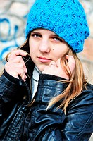 teen girl wearing blue hat