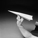 Man holding paper airplane, close_up