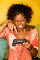 African_American woman plays video game