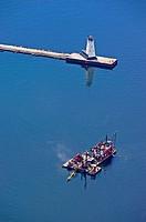 Dredge boat working the Ludington, Michigan harbor, Michigan, USA
