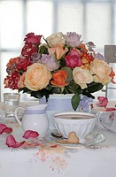 Bunch of flowers and coffee set on dining table