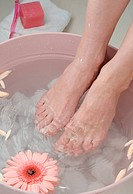 Woman taking footbath
