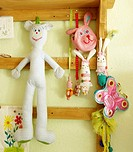 Cuddly toys hanging at wooden beams