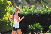 Young Women Jogging Outdoor in the Sunny Day