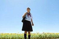 Schoolgirl in Sunflower Field