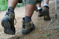 Hikers walking on path, close_up of feet