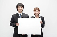Businesswoman and Businessman Holding Blank Message