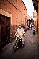Man driving a motorcycle, Marrakech, Morocco