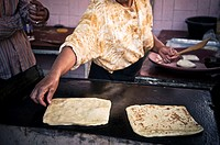 woman making bread, Azilal, Morocco