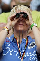 WOLFSBURG, GERMANY - JULY 9: A spectator uses binoculars to watch the action at the 2011 Women´s World Cup quarterfinal soccer match between Germany a...