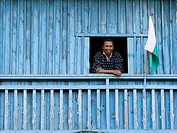 Smiling Malagasy man at a window, Madagascar
