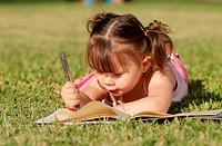 The little girl in park. Portrait