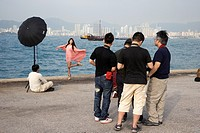 photographers taking photos of a model on hong kong island, hksar, china