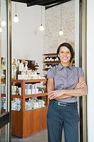 Mixed race business owner standing in beauty product store