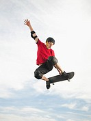 Caucasian man on skateboard in mid_air
