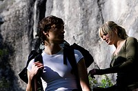 Young couple hiking in the mountains