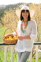 Woman with basket of home grown lemons