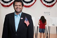 Voter standing in polling place