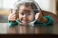Caucasian girl holding fish bowl