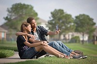 Mixed race couple taking self_portrait with cell phone