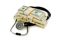 Concept of expensive healthcare with dollars and stethoscope
