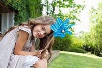 Girl in backyard holding pinwheel
