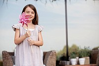 Girl holding pinwheel outdoors