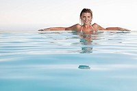 Woman enjoying infinity pool