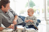 Father and son playing with pots and pans
