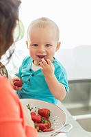 Baby eating strawberries